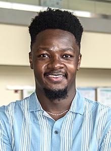 headshot of Expery Omollo